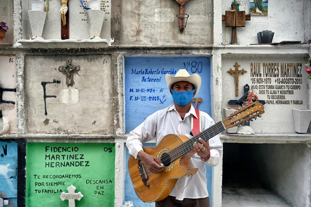 Funeral musician Humberto Montes waits to offer his services at Ciudad Nezahualcoyotl's municipal cemetery