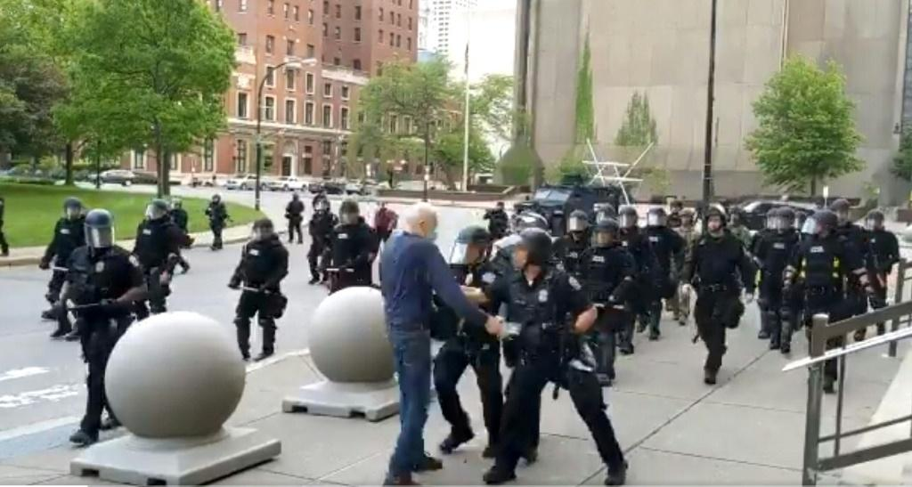 Police are seen shoving a 75-year-old protester to the ground in Buffalo, New York, on June 4, 2020
