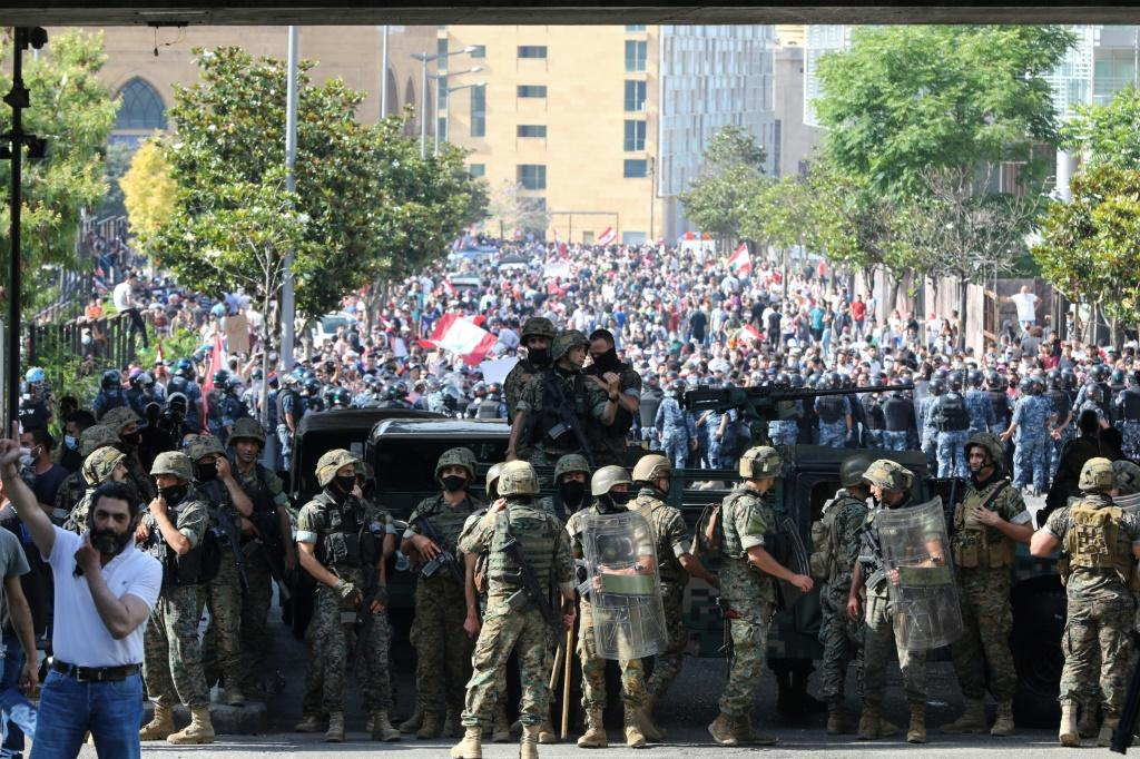 Lebanese army soldiers and security forces deployed in central Beirut to contain the anger of the protesters