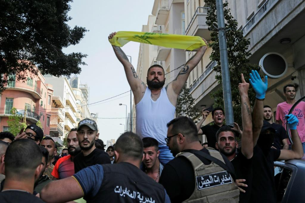 Lebanese army troops form a human chain to separate supporters of Hezbollah from other demonstrators after they clashed during a protest in central Beirut