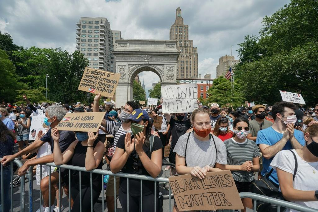 Protesters fill New York's Washington Square Park during a peaceful protest against police brutality and racism, on June 6, 2020