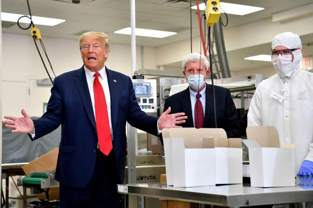 US President Donald Trump (L) says the economy is bouncing back from the virus lockdowns