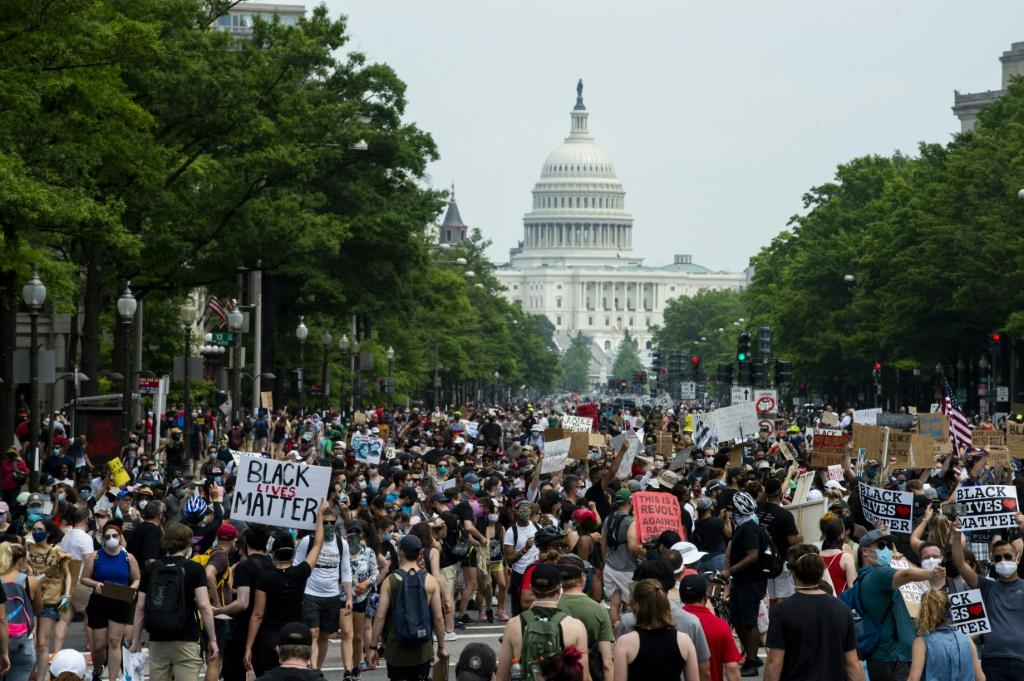 A crowd of protesters walk from the Capitol building to the White House during a peaceful protest against police brutality and racism, on June 6, 2020 in Washington, DC