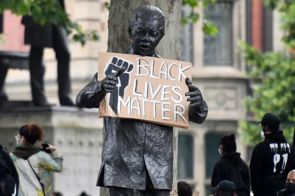 A statue of Nelson Mandela is seen holding a Black Lives Matter placard in London's Parliament Square as demonstrators show solidarity with the Black Lives Matter movement in the wake of the George Floyd killing