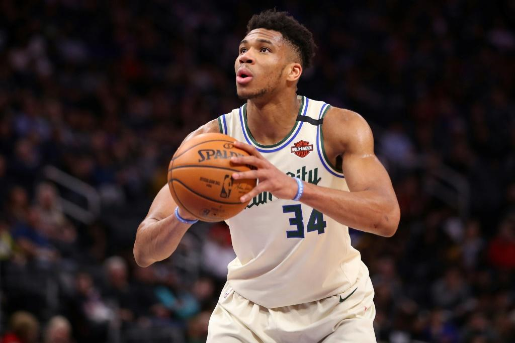 """Giannis Antetokounmpo of the Milwaukee Bucks wore a shirt reading """"I can't breathe,"""" a reference to George Floyd's last words, to a Black Lives Matter protest"""