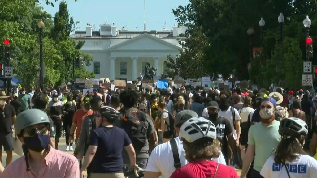 IMAGES Protesters gather peacefully in the afternoon in Washington, DC, to demonstrate peacfully against police brutality. Crowds flock to the White House and walk along the newly-renamed Black Lives Matter Plaza.