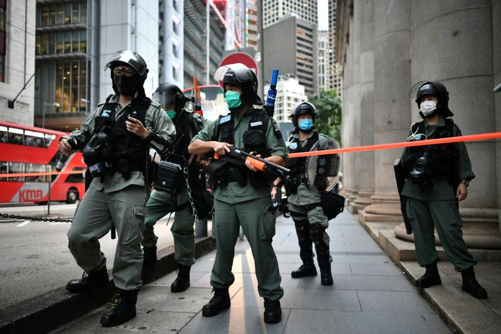Riot police stand guard ahead of a pro-democracy march in the Central district of Hong Kong