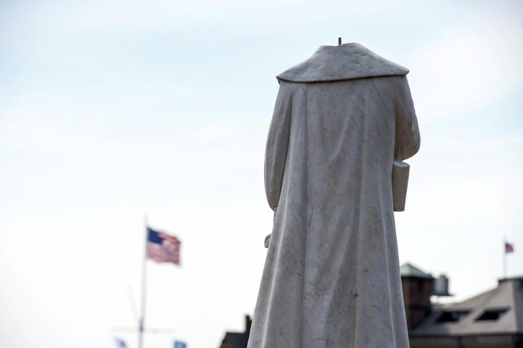 A decapitated statue of Columbus is seen at Christopher Columbus Park in Boston, Massachusetts on June 10