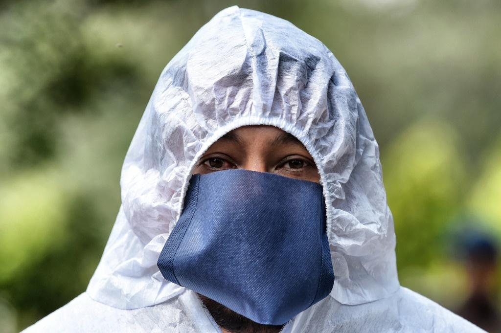 Latin America has now suffered at least 70,000 dead from the coronavirus outbreak and in Mexico funeral workers wear full protective equipment