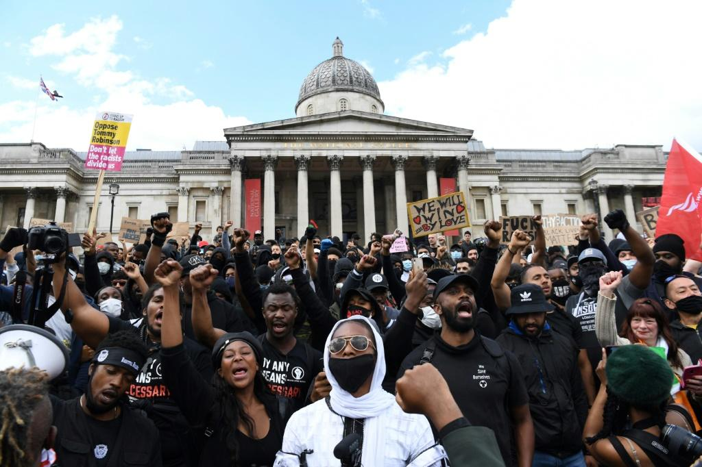 A march by several hundred Black Lives Matter activists through the British capital went ahead at lunchtime Saturday, ending in Trafalgar Square near where counter protesters had gathered and amid a heavy police presence