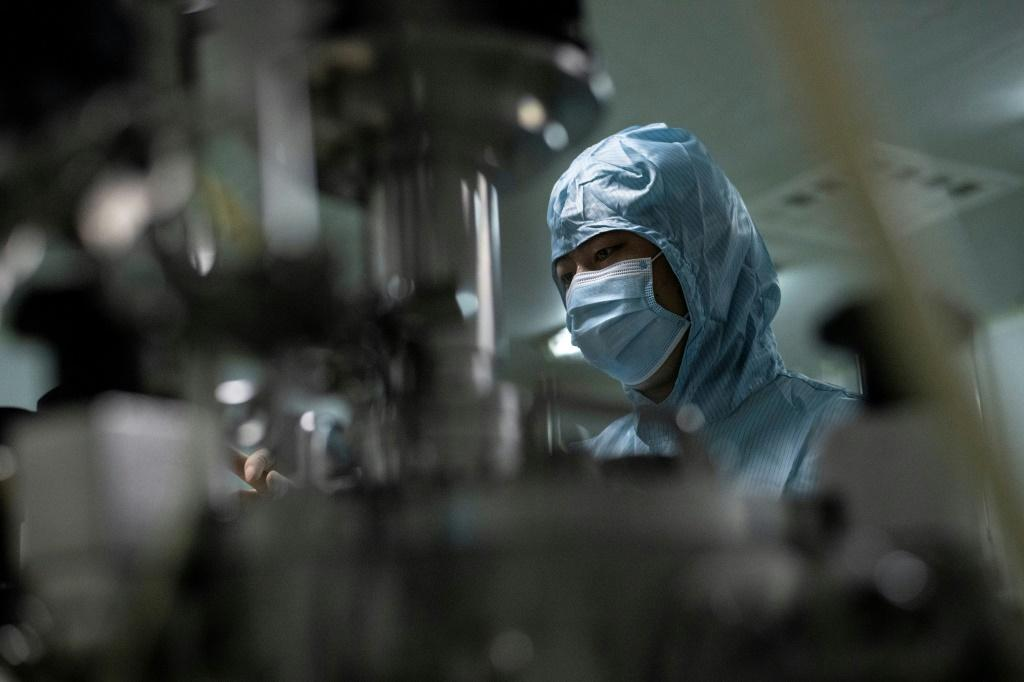 A researcher at the Yisheng Biopharma company lab in Shenyang, one of a number of firms in China trying to develop a vaccine for COVID-19