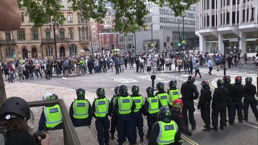 IMAGESThousands of people, gather at a far-right linked protest in London to 'guard' the statue of Winston Churchill as fears it will be vandalised grow. Some protesters clashed with police and were seen throwing projectiles at officers. The gathering was