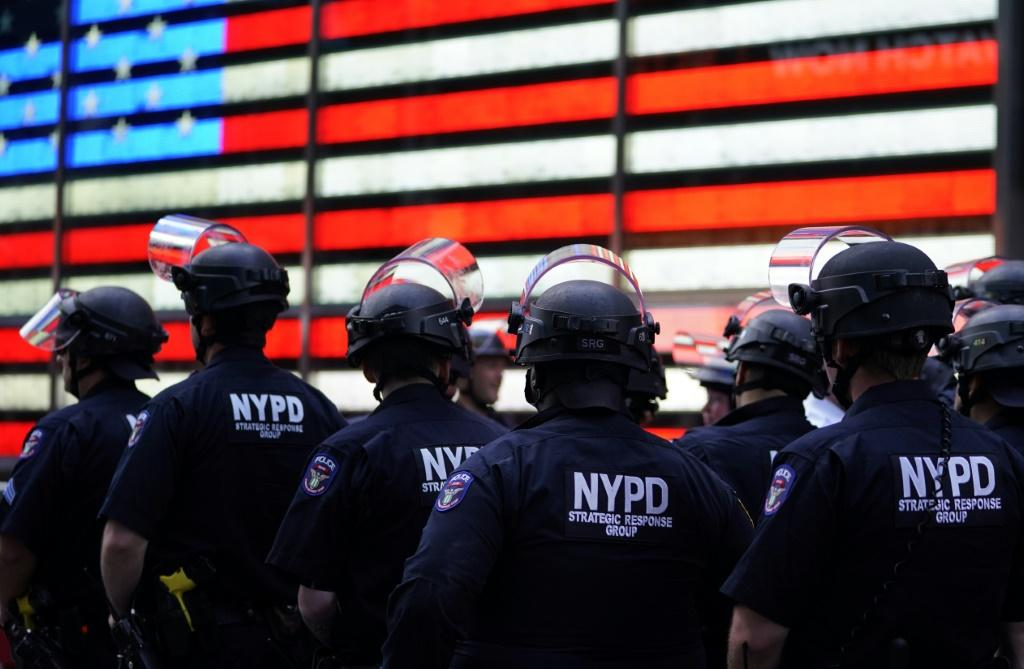 NYPD police officers watch demonstrators in Times Square on June 1 during a Black Lives Matter protest