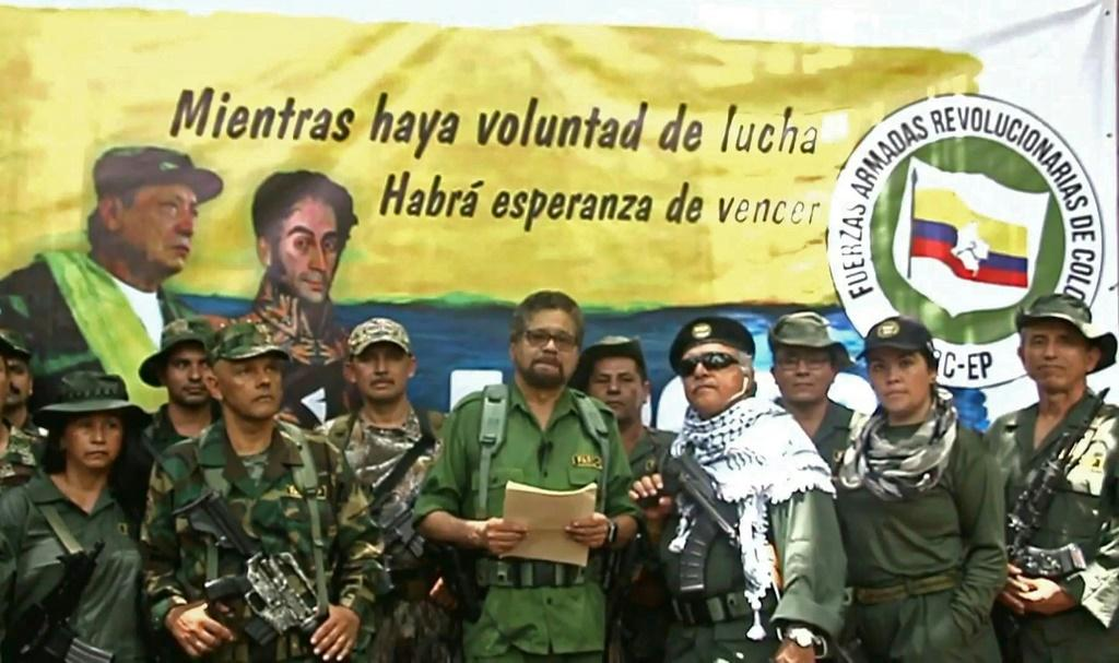 FARC former senior commander Ivan Marquez (center) and fugitive rebel colleague Jesus Santrich(wearing sunglasses) announce a return to arms in an August 2019 YouTube video