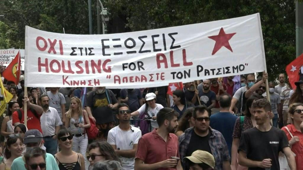 Around 2,000 people gather across central Athens to mark World Refugee Day and protest the Greek government's migrant policies. Members of anti-racist groups, joined by refugees from migrant camps, march holding banners and chanting against evictions of