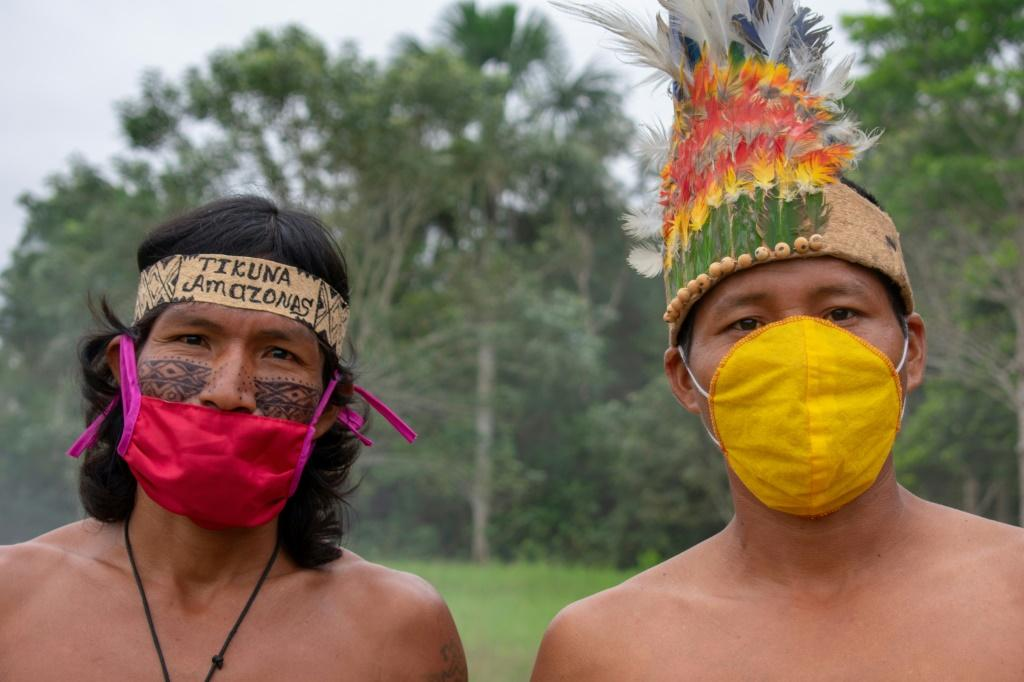 Members of the Ticuna community in El Progresso, Colombia pose with face masks