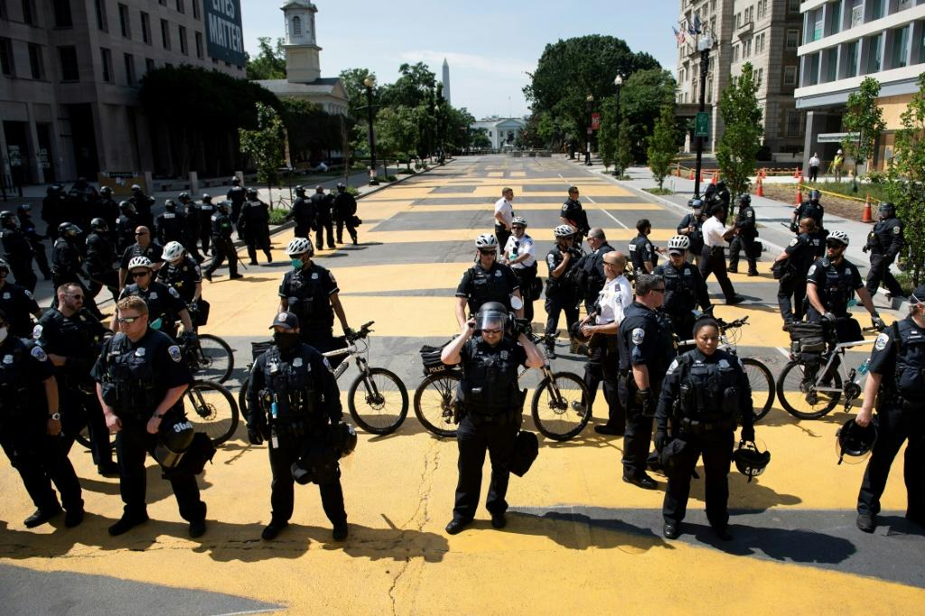 DC Police hold a line after pushing a small group protestors out of Black Lives Matter Plaza near the White House.