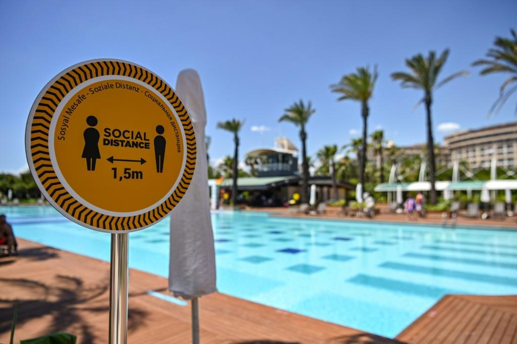 """People are careful, they spend their holidays respecting social distancing rules,"""" sunbather Deniz Kaya said"""