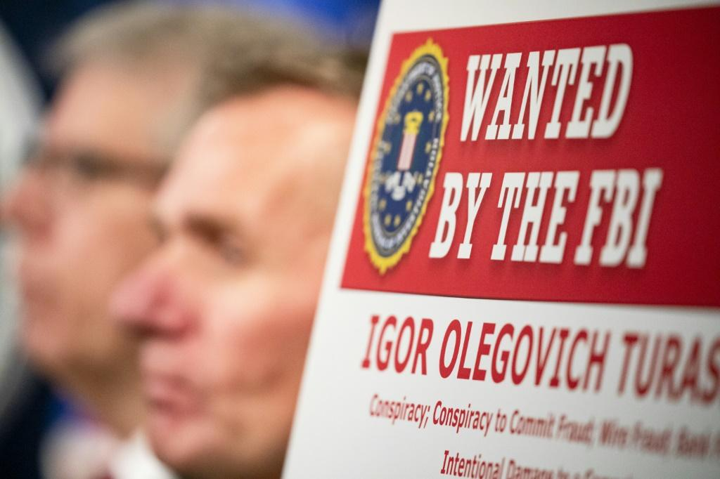 Two Russian nationals indicted on charges of hacking in December are believed to be behind a new ransomware scheme targeting US firms, according to security experts