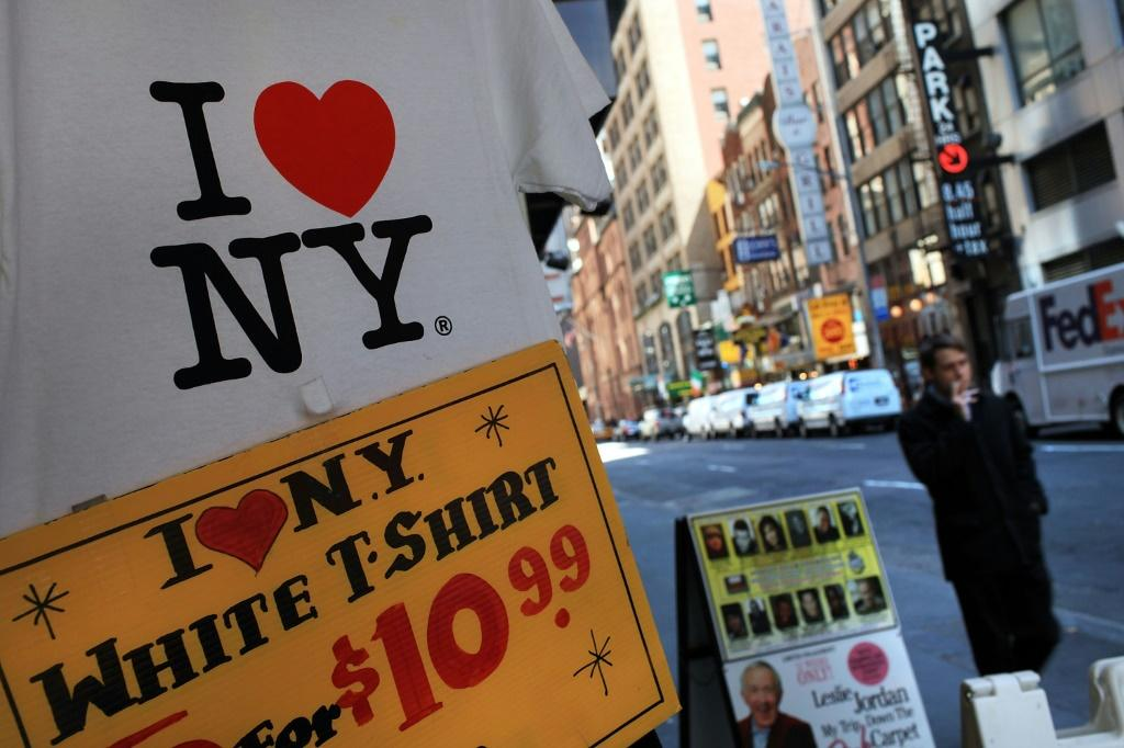 "A T-shirt with the famous ""I (Heart) NY"" logo designed by Milton Glaser is on display at a Times Square store in New York City"