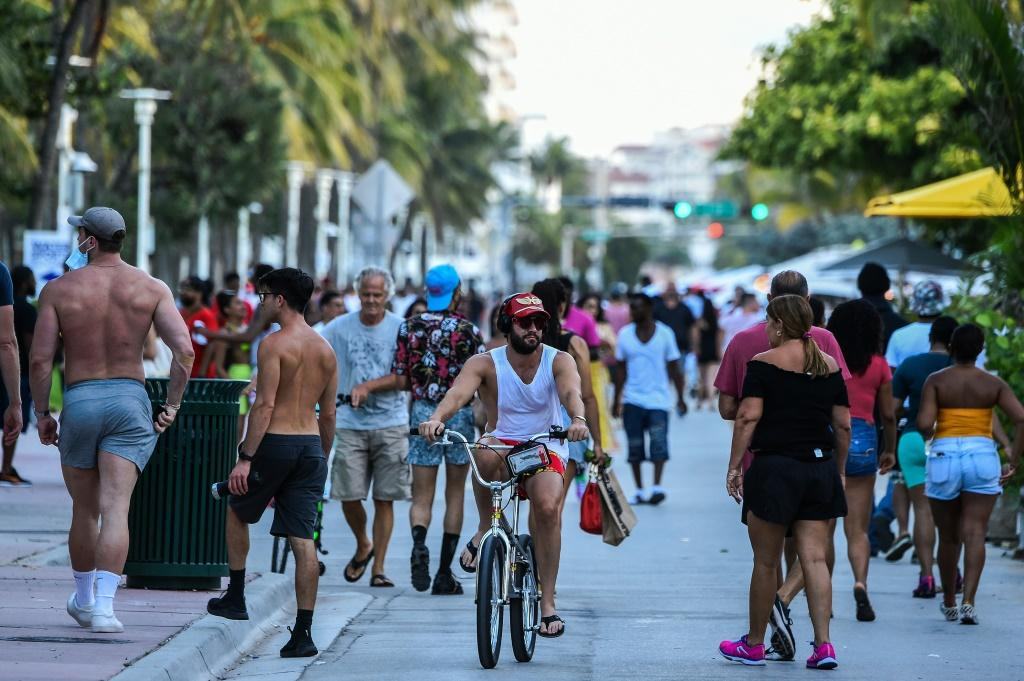 Fun-seekers out and about on Ocean Drive in Miami Beach, Florida on June 26, 2020 -- itching for a good time after months of lockdown
