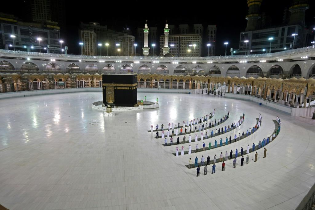 A handful of worshippers pray at the Islam's holiest shrine, the Grand Mosque complex in Saudi Arabia's holy city of Mecca, usually teeming with pilgrims as the annual hajj pilgrimage approaches