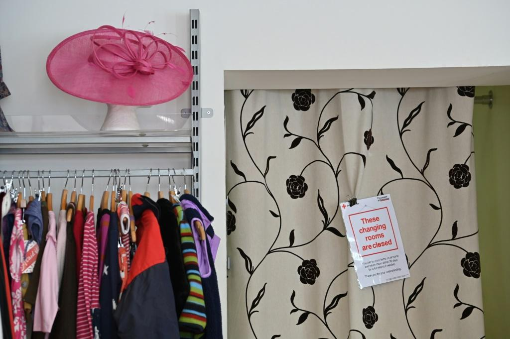 A sign indicates that the changing rooms are closed as a measure against the spread of COVID-19 at a British Red Cross charity shop in London