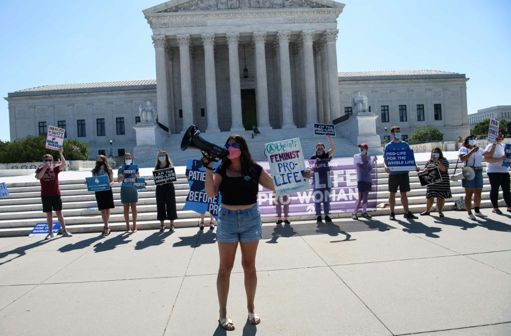 Anti-abortion activists demonstrate in front of the US Supreme Court on June 29, 2020