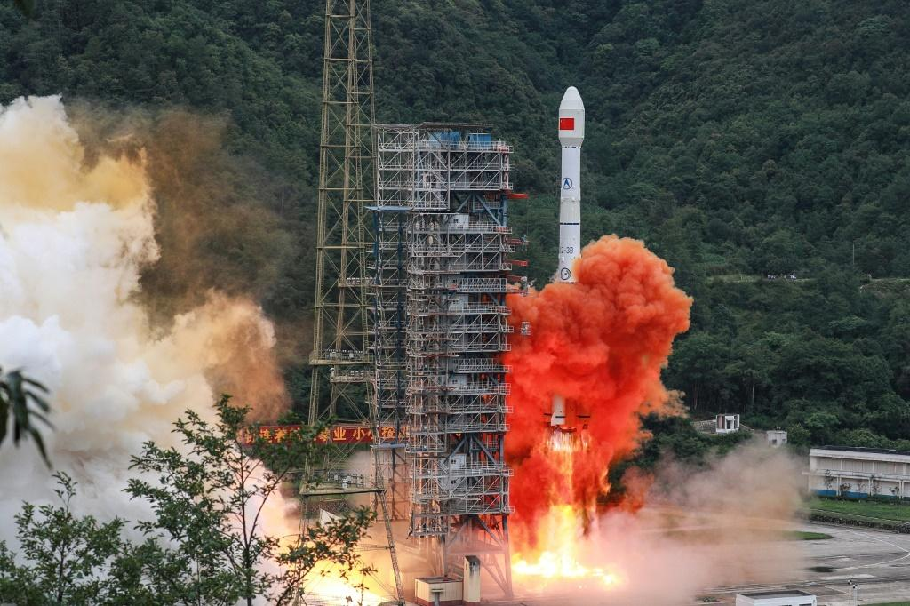 A Long March rocket lifts off from the Xichang Satellite Launch Center in Xichang in China's southwestern Sichuan province in June 2020