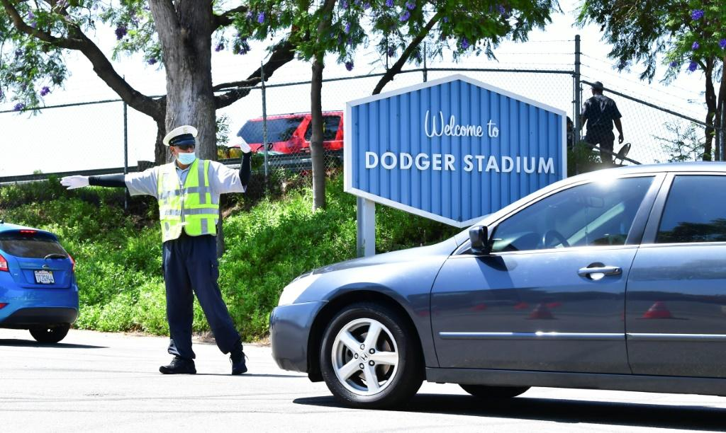 People arrive for COVID-19 testing at Dodger Stadium in Los Angeles, California
