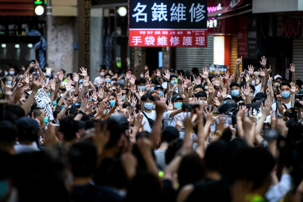 Protesters chant slogans during a rally against a new national security law in Hong Kong on the anniversary of the city's handover from Britain