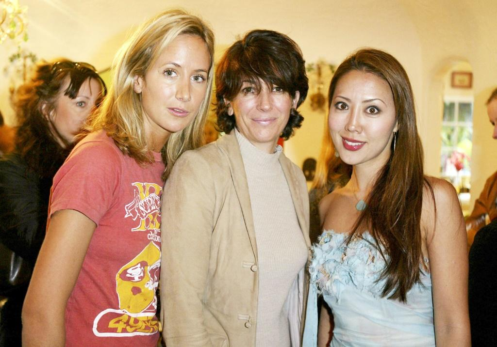Ghislaine Maxwell (C) pictured in 2004 has been arrested by the FBI on charges linked to Jeffrey Epstein's sex crimes