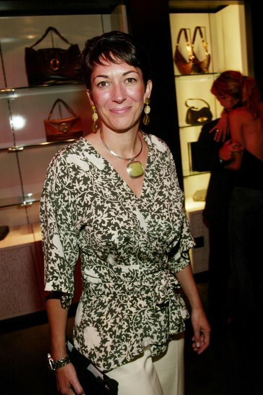 Socialite Ghislaine Maxwell, arrested in July 2020 for alleged sex crimes, attends a 2003 Yves Saint Laurent Boutique Opening Party