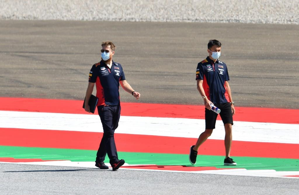 Track and trace: Red Bull's Thai driver Alex Albon (right) inspects the circuit on Thursday