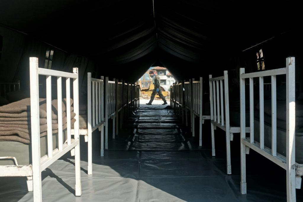 A Serbian army soldier walks past a makeshift field hospital to accomodate patients in the city of Novi Pazar on July 3, 2020