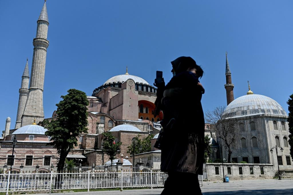 A woman takes a picture at the Hagia Sophia in Istanbul on July 2, 2020