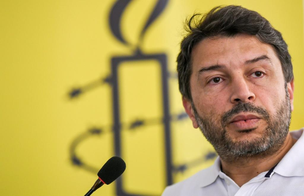 "Taner Kilic, pictured in August 2018 when he was Amnesty International Turkey's chair, was sentenced to six years and three months for ""membership of a terrorist organisation"