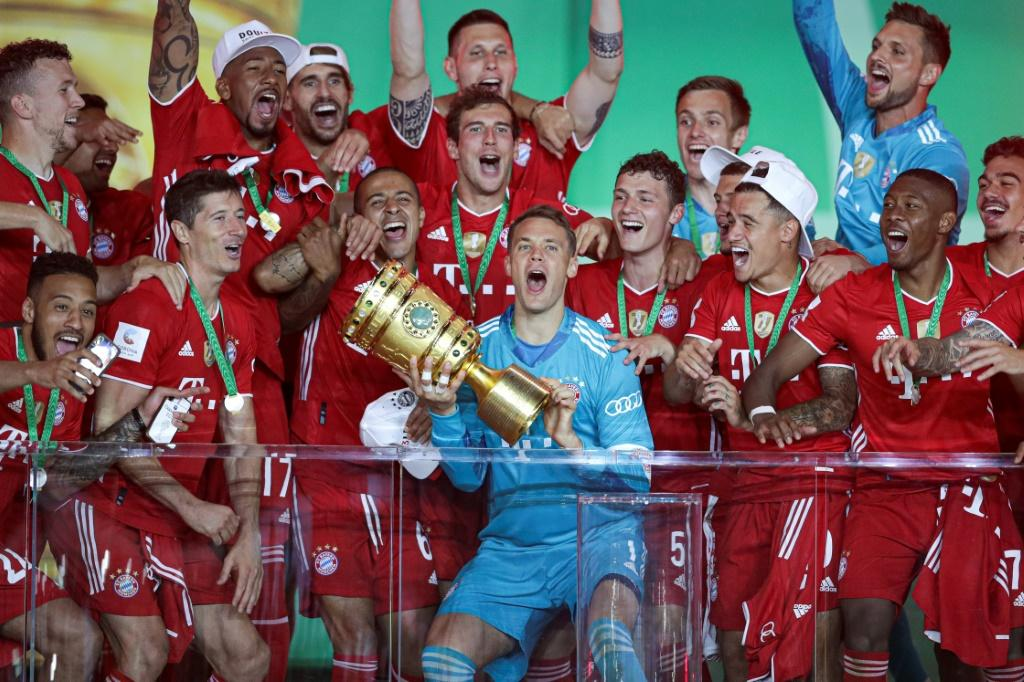 Bayern Munich goalkeeper Manuel Neuer lifts the German Cup trophy after Saturday's 4-2 win over Bayer Leverkuen on Saturday in Berlin.