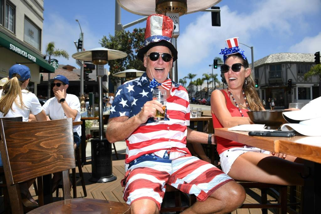 Dave Barnes enjoys lunch with his wife Christy Barnes at an outdoor restaurant in Manhattan Beach, California where beaches are closed due to a spike in COVID-19 cases