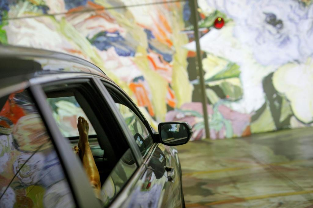 People sit in their cars as they experience a drive-in immersive Vincent Van Gogh art exhibit in Toronto, Ontario, Canada, on July 3, 2020. Amid the coronavirus pandemic, many events are having to rethink their programming and innovate in order to comply
