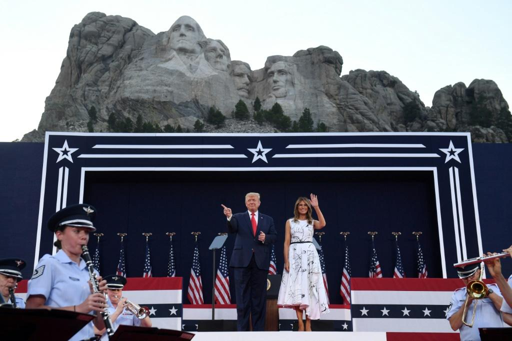 US President Donald Trump, shown here with First Lady Melania Trump, said little about the coronavirus during his remarks at Mount Rushmore