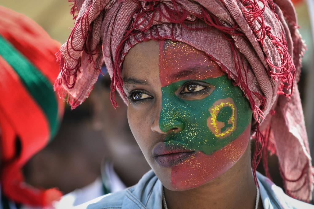 Follower: A woman's face is painted with the flag of the Oromo Liberation Front at celebrations in September 2018 to mark the return of the once-banned OLF to Addis Ababa
