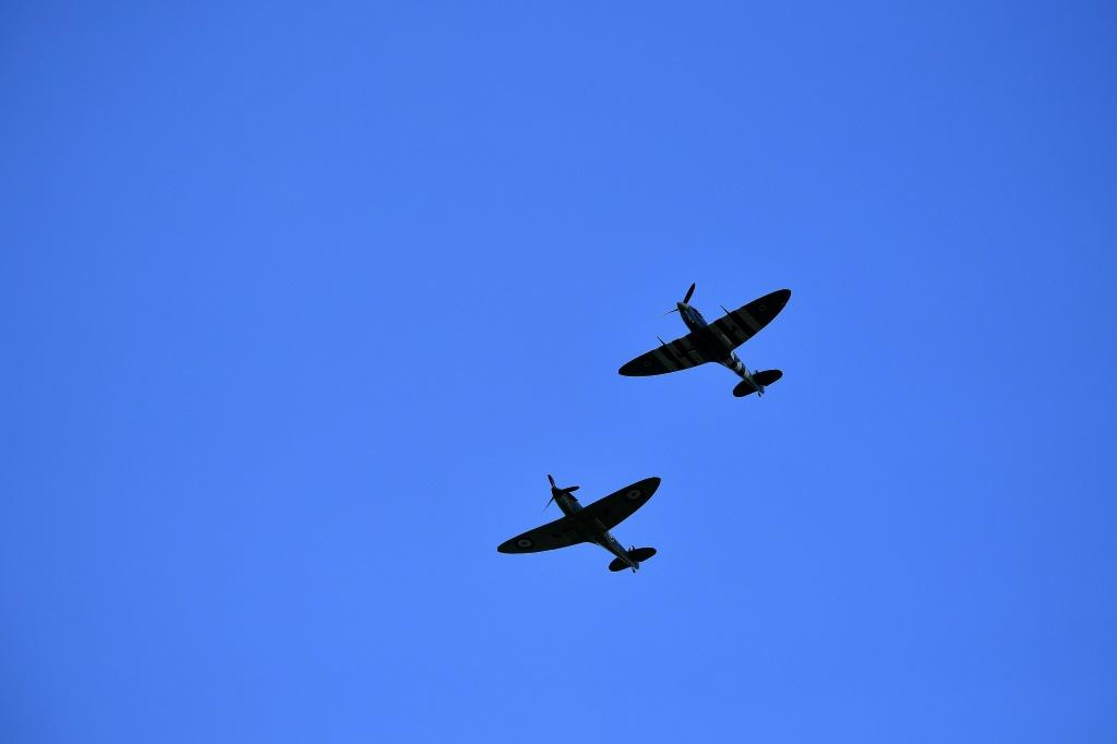 Crowds broke into applause as WWII Spitfire fighter planes performed a flypast