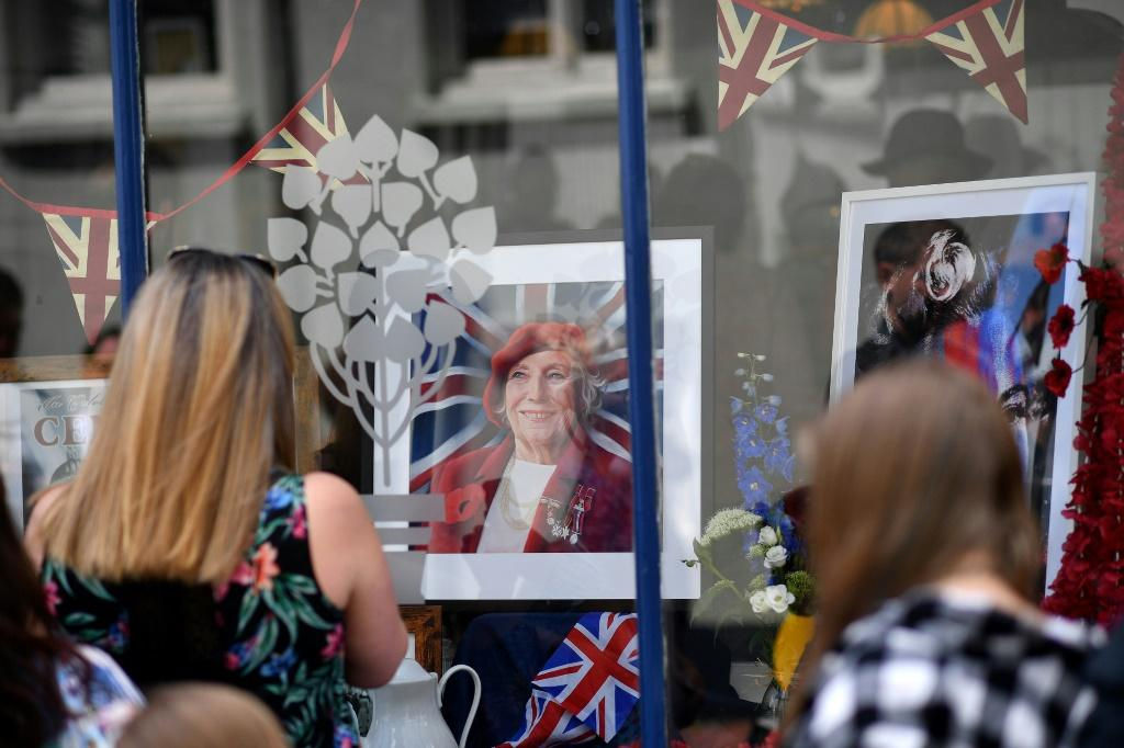 Crowds thronged Vera Lynn's former home of Ditchling in southeast England to catch a glimpse of her funeral cortege