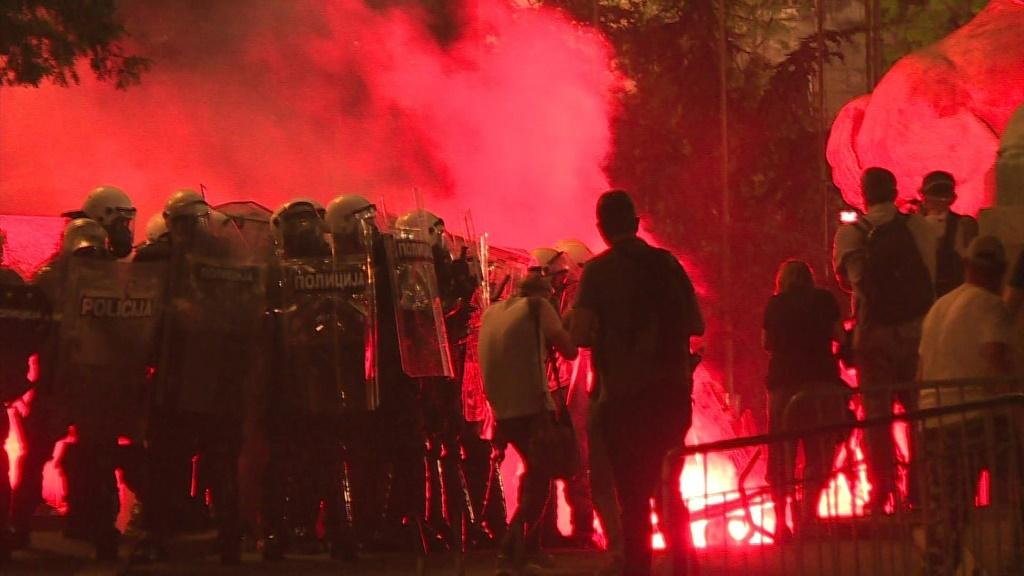 Protesters hurl firecrackers and flares at police in a fourth night of demonstrations