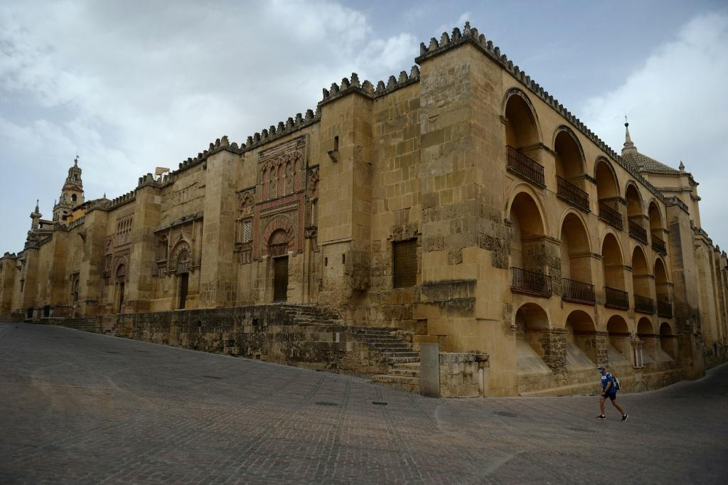 A lone tourist walks around The Mezquita in Cordova, one of Spain's interior cities that is being disproportionately hit by the drop in tourism