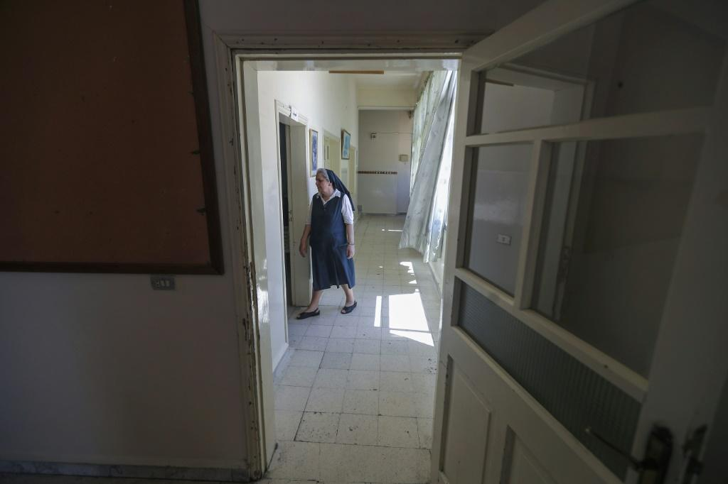 A nun walks down an empty hallway at Our Lady of Lourdes school in the Lebanese city of Zahle. French-speaking schools are mostly private and a majority are of them Catholic
