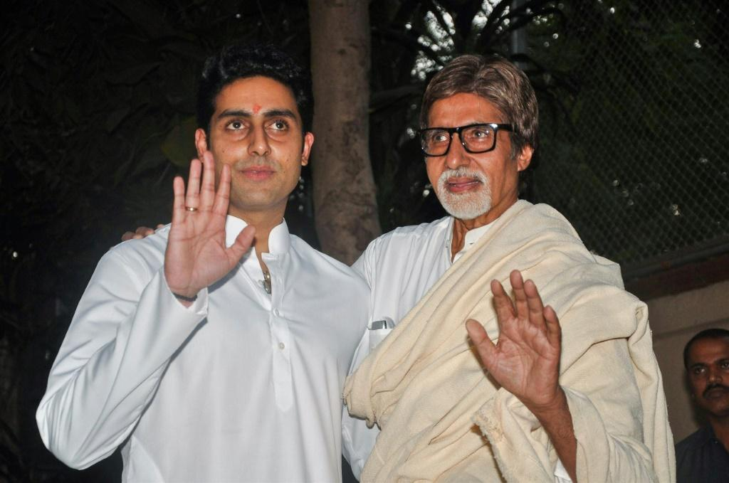 Abhishek Bachchan (L) said he and his father Amitabh Bachhan, affectionately known as 'Big B', had been admitted to hospital with the coronavirus