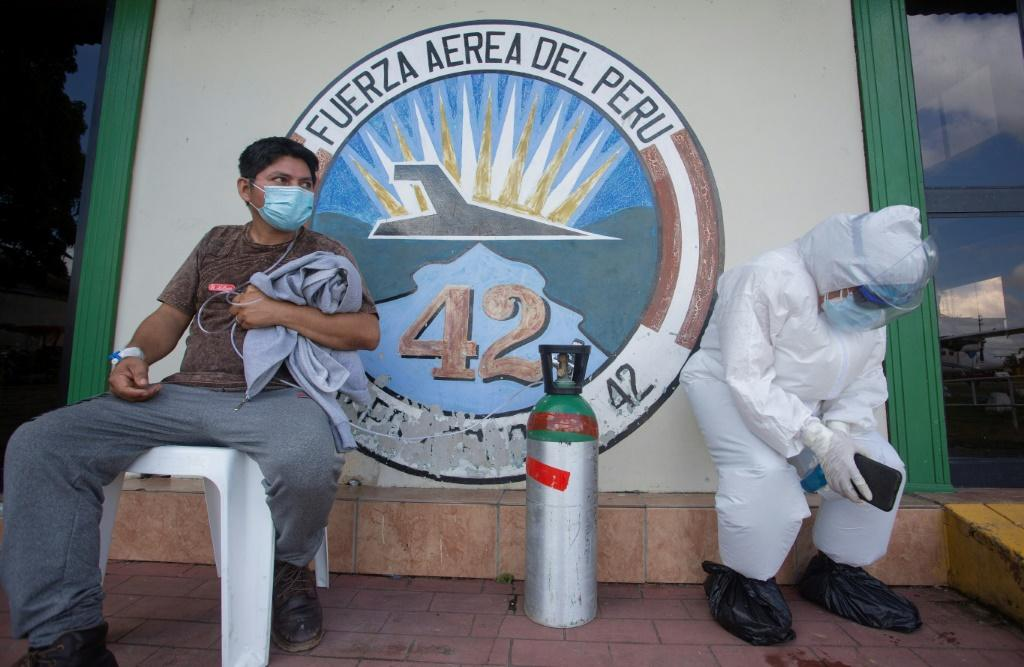 Exhausted medical workers in Peru, as Latin America's number of coronavirus deaths passed the US and Canada on Monday