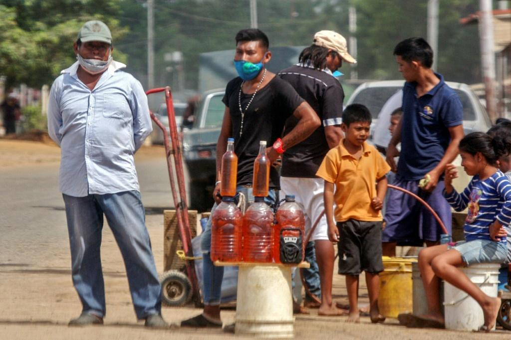 People offer gasoline for sale on the streets of Maracaibo, Venezuela in July 2020